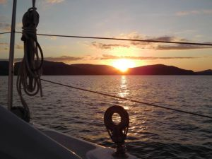 Sunset from deck of Two Up Together Airlie Beach Race Week